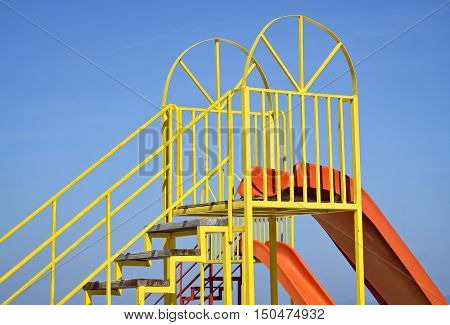 Detail of a children playground and clear blue sky