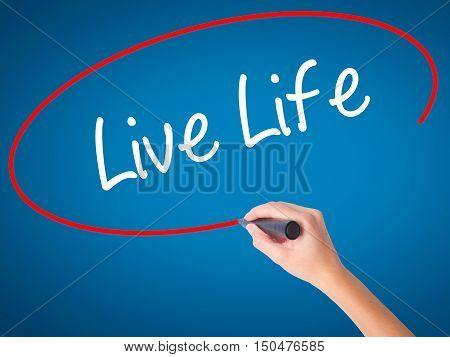 Women Hand Writing Live Life With Black Marker On Visual Screen