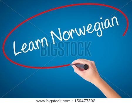 Women Hand Writing Learn Norwegian With Black Marker On Visual Screen.