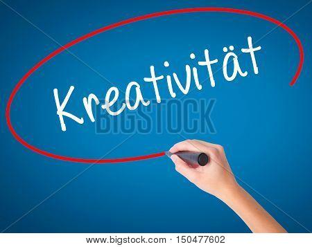 Women Hand Writing Kreativität (creativity In German)   With Black Marker On Visual Screen