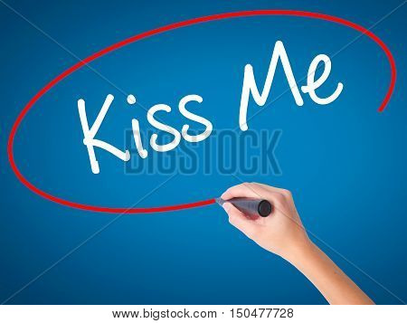 Women Hand Writing Kiss Me With Black Marker On Visual Screen