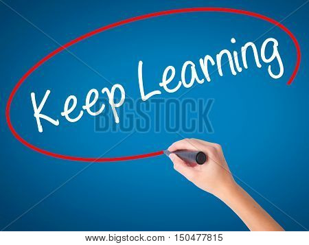 Women Hand Writing Keep Learning With Black Marker On Visual Screen