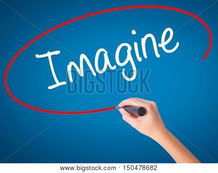 Women Hand Writing Imagine  With Black Marker On Visual Screen