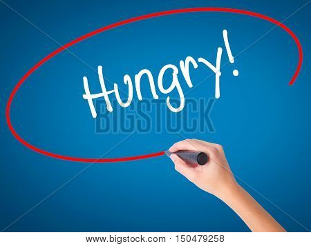 Women Hand Writing Hungry! With Black Marker On Visual Screen