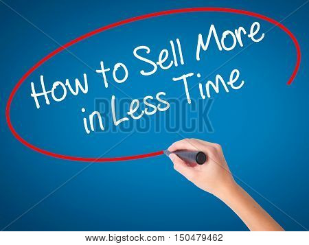 Women Hand Writing How To Sell More In Less Time With Black Marker On Visual Screen.