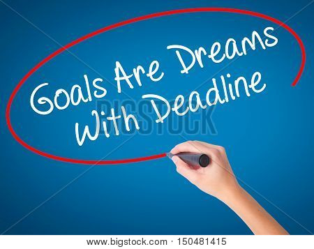 Women Hand Writing Goals Are Dreams With Deadline With Black Marker On Visual Screen