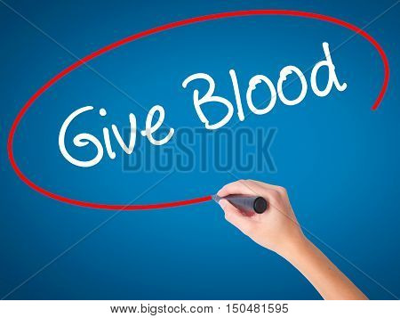 Women Hand Writing Give Blood  With Black Marker On Visual Screen