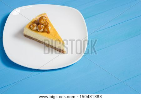 Homemade cheesecake with macadamia and caramel sauce topping. You can apply for cake background cake backdrop cake wallpaper cake with text and everything about cake background concept.