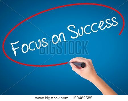 Women Hand Writing Focus On Success With Black Marker On Visual Screen