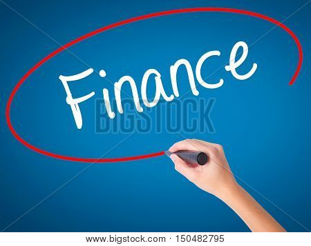 Women Hand Writing Finance With Black Marker On Visual Screen.