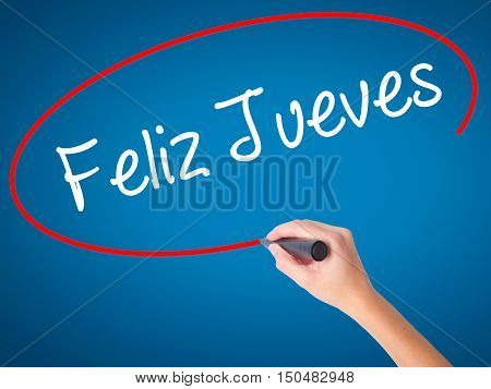 Women Hand Writing Feliz Jueves (happy Thursday In Spanish) With Black Marker On Visual Screen.