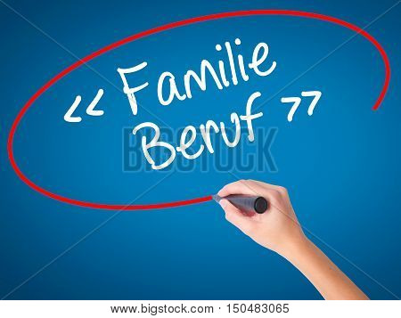 Women Hand Writing Familie Beruf (family Occupation In German) With Black Marker On Visual Screen