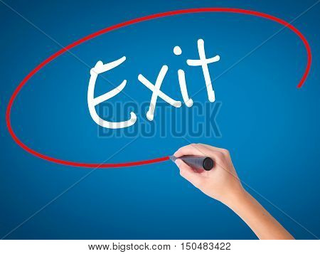 Women Hand Writing Exit With Black Marker On Visual Screen