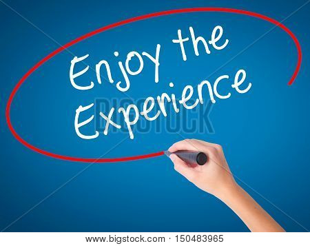 Women Hand Writing Enjoy The Experience With Black Marker On Visual Screen