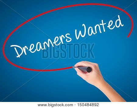 Women Hand Writing Dreamers Wanted  With Black Marker On Visual Screen