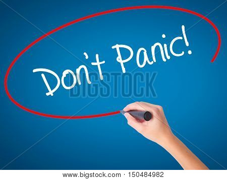 Women Hand Writing Don't Panic! With Black Marker On Visual Screen