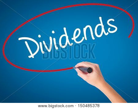 Women Hand Writing Dividends With Black Marker On Visual Screen