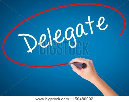 Women Hand Writing Delegate With Black Marker On Visual Screen