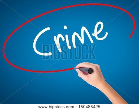 Women Hand Writing Crime With Black Marker On Visual Screen