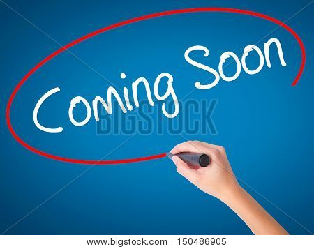 Women Hand Writing Coming Soon With Black Marker On Visual Screen