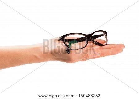 hand giving eyeglasses. isolated on white background