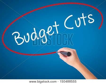Women Hand Writing Budget Cuts With Black Marker On Visual Screen
