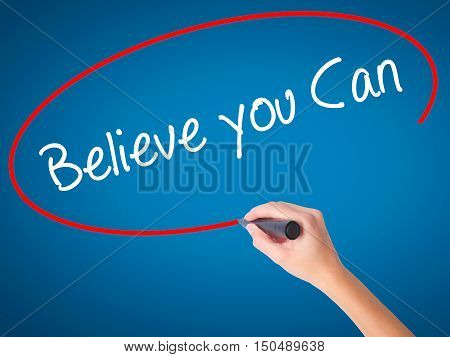 Women Hand Writing Believe You Can With Black Marker On Visual Screen