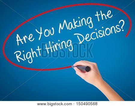 Women Hand Writing Are You Making The Right Hiring Decisions? With Black Marker On Visual Screen