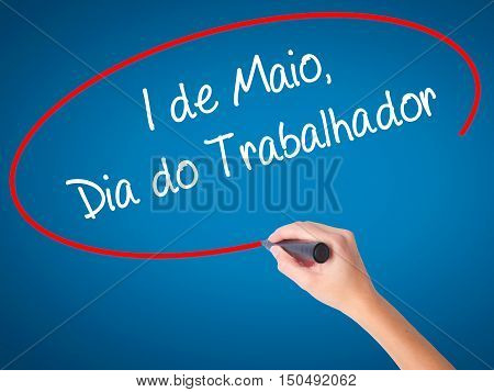 Women Hand Writing  1 De Maio, Dia Do Trabalhador (in Portuguese: 1 May, Labor Day)  With Black Mark