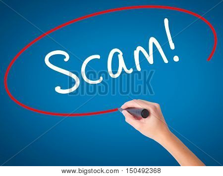 Women Hand Writing  Scam! With Black Marker On Visual Screen