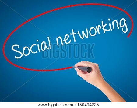 Man Hand Writing Social Networking With Black Marker On Visual Screen