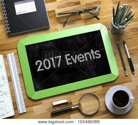 2017 Events Concept on Small Chalkboard. Business Concept - 2017 Events Handwritten on Green Small Chalkboard. Top View Composition with Chalkboard and Office Supplies on Office Desk. 3d Rendering.