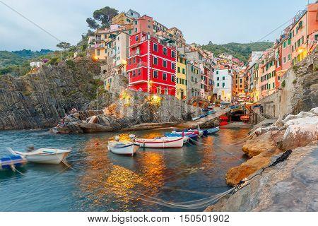 Riomaggiore fishing village in the evening, seascape in Five lands, Cinque Terre National Park, Liguria, Italy.