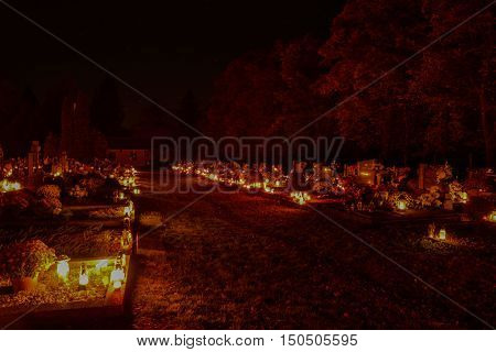 Tvrdomestice, Slovakia - 2.11.2015: Votive Candles Lantern Burning On Graves In Cemetery At Night Ti