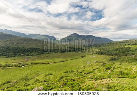 nature and landscape concept - view to plain with lake or river at Killarney National Park valley in ireland