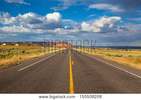 Long empty highway road in desert, Arizona, USA