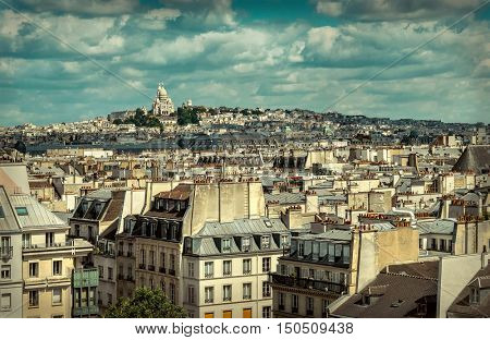French roofs. Beautiful roofs view in Paris City downtown with skyline under sunlight at day time.