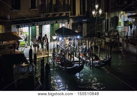 VENICE - 27 JUNE 2014: Gondola kiosk at night on the Grand canal on 27 June 2014 in Venice, Italy. Editorial use only.