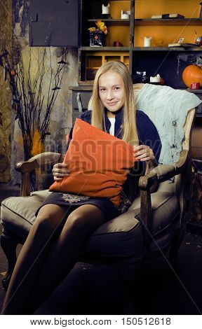 pretty blonde girl selebrating halloween in fairy interior, lifestyle happy smiling people concept close up