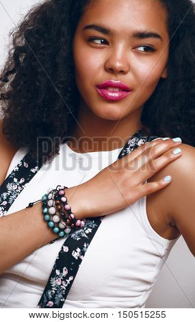 young pretty african american teenage girl happy smiling close up on white background, lifestyle real people concept