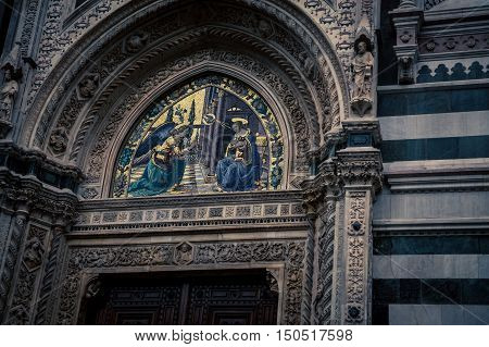Religious fresco on the entrance of a church in florence