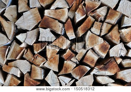 Natural Wooden Background, Chopped Firewood. Firewood Stacked For Winter