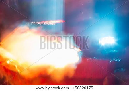 Abstract blur background pattern with space bright colorful orange laser rays, smoke and flash