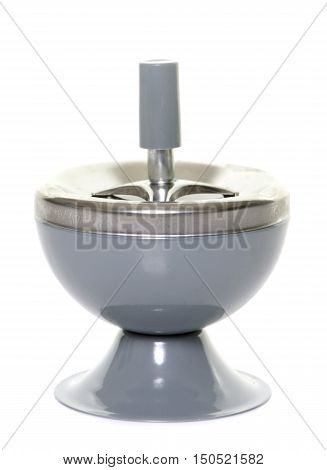 metal ashtray in front of white background