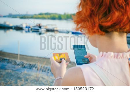 Girl With Red Hair Walking By The River At Sunset, To Make Payments For Online Purchases From Your D