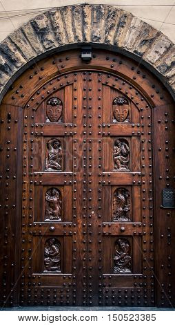 Intricate door on a cathedral in Florence Italy