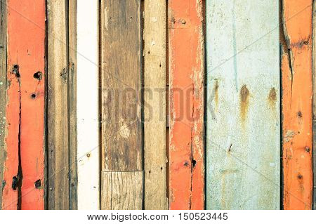 Wooden background and alternative construction material - Texture on multicolored wood panel in modern fashion structure - Retro seamless backdrop pattern - Soft vintage desaturated filtered look