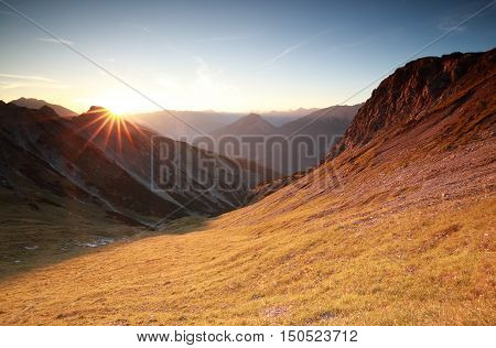 autunm sunrise over mountains in Alps Austria