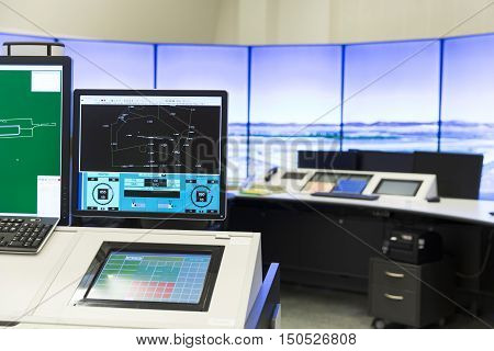 Sofia Bulgaria - September 12 2016: An air traffic controller is directing flights during a working day at Bullgaria's Air Traffic Services Authority control center room. Computer monitors. No people.