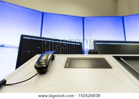 Sofia Bulgaria - September 12 2016: Bullgaria's Air Traffic Services Authority control center room. Controller's phone on the desk near control computer monitors. No people.